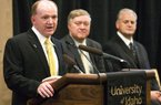 Idaho's new football coach, Paul Petrino, left, speaks while university President Duane Nellis, center, and athletic director Rob Spear listen during a news conference in Moscow, Idaho, on Monday. Petrino replaces interim coach Jason Gesser, who guided the Vandals during the final four games after Robb Akey was fired. Petrino has been the offensive coordinator and quarterbacks coach at Arkansas.