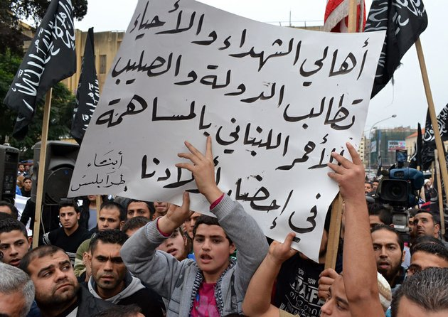 lebanese-supporters-of-islamic-group-hold-a-poster-with-arabic-that-reads-the-parents-of-the-martyrs-and-those-still-living-demand-the-republic-and-the-lebanese-red-cross-contribute-to-bring-our-children-during-a-protest-in-the-northern-city-of-tripoli-lebanon-on-monday-dec-3-2012