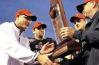Arkansas State head coach Gus Malzahn, from left, quarterback Ryan Aplin and linebacker Nathan Herrold are presented with the Sun Belt Conference trophy following their NCAA college football game against Middle Tennessee on Saturday. Malzahn was hired as head coach at Auburn on Tuesday.
