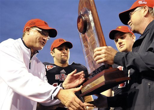 arkansas-state-head-coach-gus-malzahn-from-left-quarterback-ryan-aplin-and-linebacker-nathan-herrold-are-presented-with-the-sun-belt-conference-trophy-following-their-ncaa-college-football-game-against-middle-tennessee-on-saturday-malzahn-was-hired-as-head-coach-at-auburn-on-tuesday