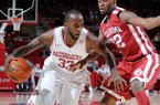 NWA Media/ANTHONY REYES -- Arkansas junior forward Marshawn Powell (33) drives around Oklahoma junior forward Amath M'Baye (22) in the first half Tuesday, Dec. 4, 2012 at Bud Walton Arena in Fayetteville.