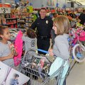 Liliana Cunningham, 6, left, shows Mindy Medina, police dispatcher, right, a movie she may want to p...