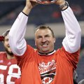 Wisconsin coach Bret Bielema holds up the trophy after Wisconsin defeated Nebraska 70-31 to win the ...