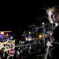 Jerri Grace Notestine, 5, (above) watches the Rogers Christmas Parade roll by Monday with her family...