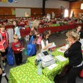 Kindergartners head to the checkout station Monday in the Holiday House at Bellview Elementary in Ro...
