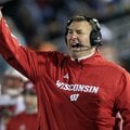 Wisconsin head coach Bret Bielema, left, stands on the sidelines during during the first quarter of ...