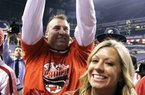 Bret Bielema and his wife Jen rejoice Saturday after Wisconsin's victory in the Big Ten Championship Game at Indianapolis. Bielema, 42, displays a Wisconsin victory sign, forming a W with his thumbs and index fingers. Today, he will likely be calling the Hogs when introduced as Arkansas' new coach.