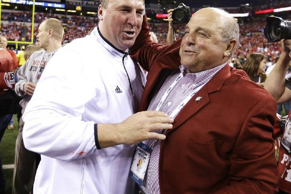 Wisconsin coach Bret Bielema, left, celebrates with athletic director Barry Alvarez after Wisconsin defeated Nebraska 70-31 to win the Big Ten dhampionship NCAA college football game Saturday, Dec. 1, 2012, in Indianapolis. (AP Photo/Darron Cummings)