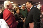 STAFF PHOTO ANDY SHUPE -- Former Arkansas athletics director Frank Broyles, left, speaks Wednesday, Dec. 5, 2012, with Bret Bielema, right, following a press conference to announce Bielema's hire as Razorbacks football coach in Fayetteville.