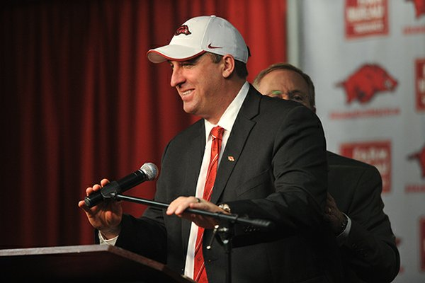 NWA Media/MICHAEL WOODS --12/05/2012-- Bret Bielema, the new University of Arkansas head football coach is introduced by athletics director Jeff Long during a press conference Wednesday afternoon.