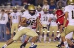 Pulaski Academy graduate Hunter Henry turns upfield during first-half action against Jacksonville on November 1, 2012. Henry signed to play for the Razorbacks this fall.