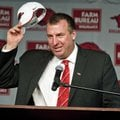 New Arkansas head coach Bret Bielema takes off his hat after being introduced during an NCAA college...