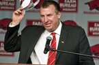 New Arkansas head coach Bret Bielema takes off his hat after being introduced during an NCAA college football news conference in Fayetteville, Ark., Wednesday, Dec. 5, 2012. Bielema, who will be paid $3.2 million annually for six years, replaces interim coach John L. Smith, who was hired after Bobby Petrino was fired in April