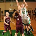 Anna Rogers, Greenland, takes a shot in the lane as Gentry's Destiny Thomas defends Tuesday in Green...