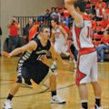 Austin Heard, left, a Bentonville senior guard, defends against Gravette's Terence Pierce during the...