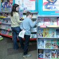Jackson Miller, 9, right, and Melissa Miller look through books during the book fair.