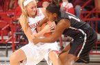 NWA Media / ANDY SHUPE -- Arkansas sophomore guard Calli Berna, left, and Texas Southern sophomore guard Janelle McQueen vie for a rebound during the first half of play Thursday, Nov. 29, 2012, in Bud Walton Arena.