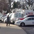 Live trucks set up outside Razorback Stadium for Bret Bielema's introduction as head coach.