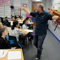 Clayton Scott, poet laureate of Fayetteville, uses props Tuesday to help teach Cori Fryar's fifth-gr...