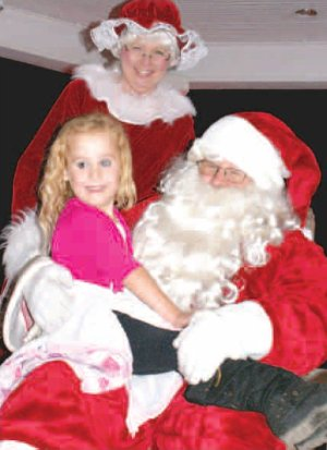 Bethany Crose showed her excitement while visiting with Santa and Mrs. Claus following the Gravette Christmas parade. Santa visited dozens of children in the band stand in Kindley Park. See next week's issue for Christmas Parade photos.