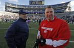Bret Bielema (right) will make $3.2 million per year as head coach at Arkansas.