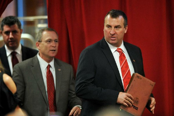 NWA Media/MICHAEL WOODS  --12/05/2012--  Bret Bielema, the new University of Arkansas head football and University of Arkansas Athletic director Jeff Long enters the room to start the press conference Wednesday afternoon at the University of Arkansas after the announcement of his hire to the football program.