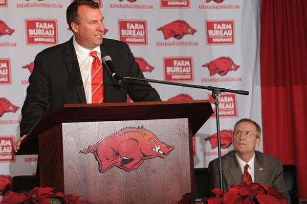 Bret Bielema speaks Wednesday during a news conference to announce his hire as the University of Arkansas' football coach at the Broyles Athletic Complex on the university's campus in Fayetteville.