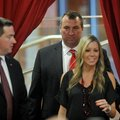 Arkansas football coach Bret Bielema follows his wife, Jen, into the Raymond Miller Room on Wednesda...