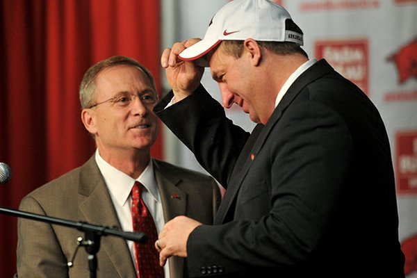 NWA Media/MICHAEL WOODS --12/05/2012-- Bret Bielema, the new University of Arkansas head football coach is introduced by athletics director Jeff Long during a press conference Wednesday.