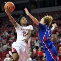 NWA Media/MICHAEL WOODS --12/06/2012-- Arkansas forward Quistelle Williams drives past Kansas defend...