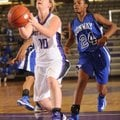 Fayetteville's Mollie Brewer attempts to score as Conway sophomore guard Jordan Danberry defends rec...