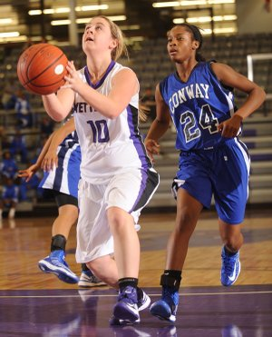 Fayetteville's Mollie Brewer attempts to score as Conway sophomore guard Jordan Danberry defends recently at Fayetteville High.