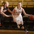 Bentonville's Taylor Lee, right, drives to the basket during the Lady Tigers' game Dec. 1.