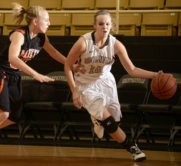 Bentonville's Taylor Lee, right, drives ...