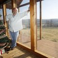 Chris Stecklein in his favorite personal space, the living room of his family's log cabin home in Ma...