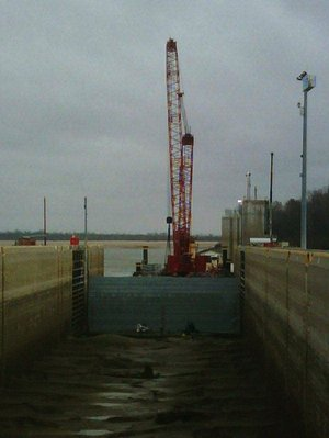 A temporary gate holds back water Wednesday at Montgomery Point Lock and Dam, allowing workers to repair hinges on lock gates. This photo was provided by the U.S. Army Corps of Engineers.