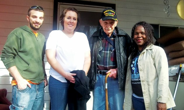 herbert-lucky-page-a-world-war-ii-veteran-stands-on-the-porch-of-the-home-he-shares-with-his-wife-monnie-on-lake-conway-volunteers-working-to-renovate-the-home-include-from-the-left-hendrix-students-eric-monroe-kaily-kilcrease-and-shenel-sandidge-executive-director-of-habitat-for-humanity-of-faulkner-county-the-nonprofit-organization-is-partnering-with-home-depot-of-conway-and-community-volunteers-on-the-project