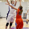 Lauren Schuldt, left, a Fayetteville sophomore forward, takes a shot in the lane over Springfield so...
