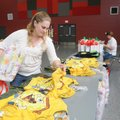 Sarah Senty selects a gift item Thursday during Operation Homefront's workshop at the Armed Forces R...