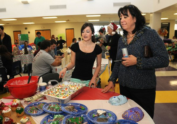Student Erica Estrada, left, shows ...