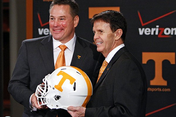 Butch Jones (left) is introduced as Tennessee's new head football coach on Friday in Knoxville, Tenn.