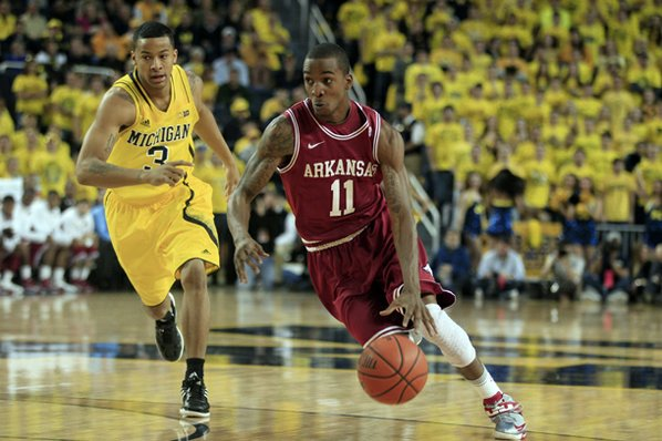 Arkansas guard BJ Young (11) ...