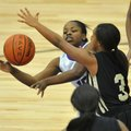 Denesha White, Fayetteville, tries to pass the ball Friday around Little Rock Central defender Taylo...