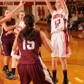 Haley Maxwell, Farmington, shoots Friday over Huntsville junior guard Vanessa Burgess at Farmington ...