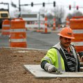 Carlos Feliz with APAC works Friday in a manhole along East Central Avenue near the intersection wit...