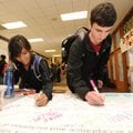 Mia Bautista, left, and Jonathan Main, Fayetteville High School seniors, sign Wednesday a pledge to ...