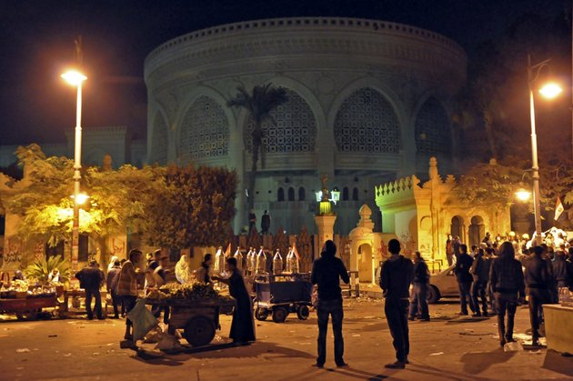 vendors-provide-demonstrators-with-food-and-drink-outside-the-presidential-palace-after-tens-of-thousands-marched-on-the-presidential-palace-pushing-past-barbed-wire-fences-installed-by-the-army-in-cairo-egypt-during-the-early-hours-of-saturday-dec-8-2012-egypt-postponed-early-voting-on-a-contentious-draft-constitution-and-aides-to-president-mohammed-morsi-floated-the-possibility-of-canceling-the-whole-referendum-in-the-first-signs-friday-that-the-islamic-leader-is-finally-yielding-to-days-of-protests-and-deadly-street-clashes