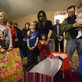 Brandon and Misty Woodell bow their heads in prayer Nov. 27 with their children Brianna, 10, left, C...