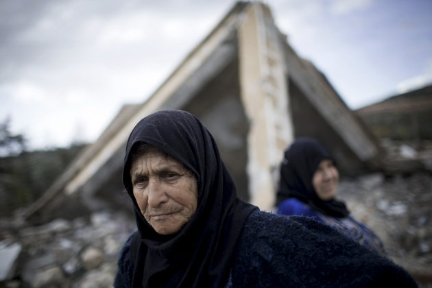 syrian-women-stand-amid-the-ruins-of-their-farm-destroyed-by-syrian-army-jets-in-al-hafriyeh-village-syria-saturday-dec-8-2012-syrian-rebel-commanders-have-elected-a-new-30-member-leadership-council-and-a-chief-of-staff-a-senior-rebel-said-saturday-in-a-major-step-toward-unifying-the-opposition-that-is-fighting-to-oust-president-bashar-assad-the-supreme-military-council-which-was-chosen-friday-during-a-meeting-in-turkey-will-work-with-the-political-leadership-that-was-chosen-last-month-in-qatar