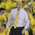 Michigan head coach John Beilein watches from the sidelines during the first half of an NCAA college...